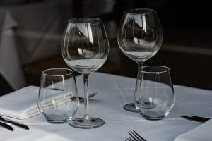 Recently washed drinking glasses on a white tablecloth